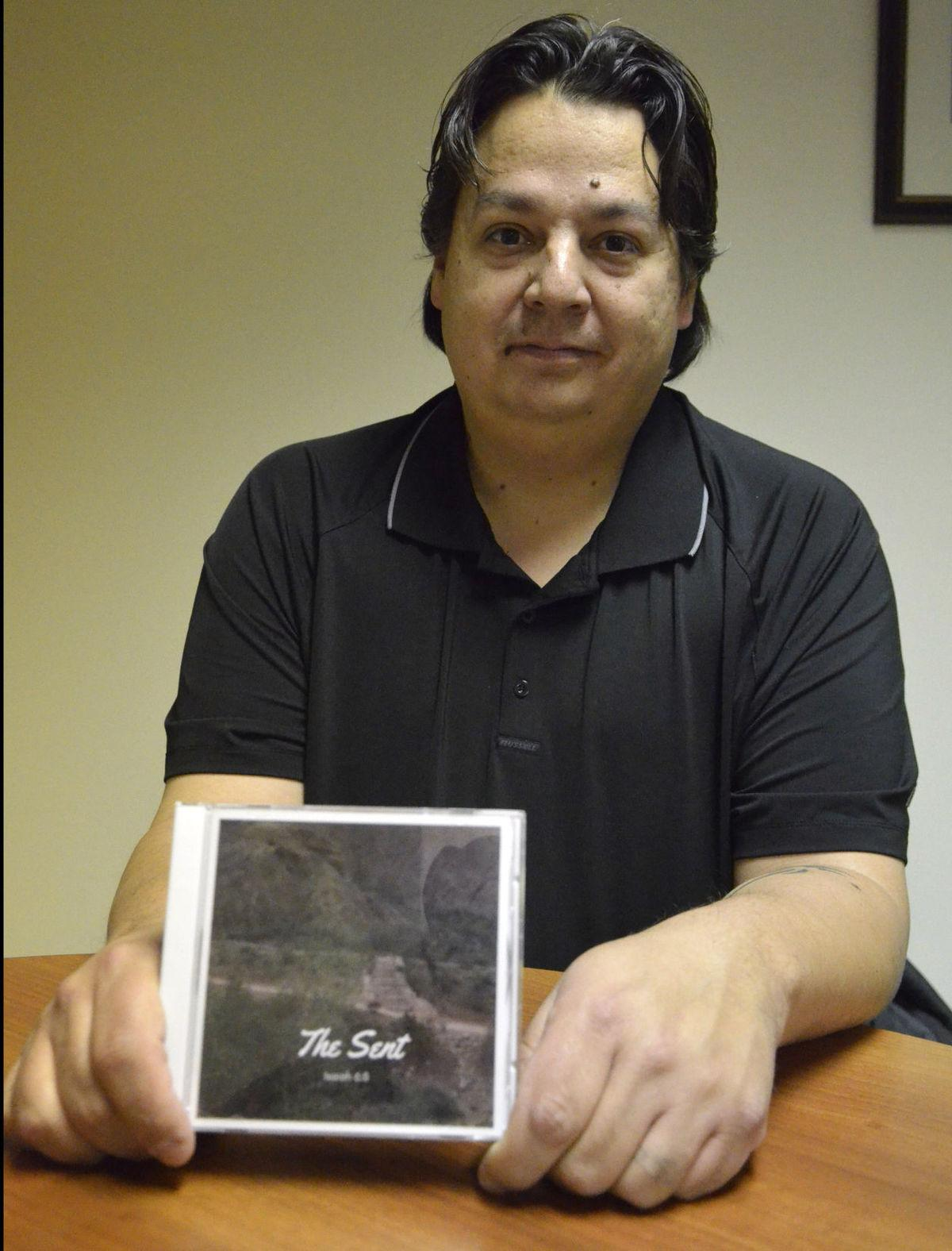 The columbus Telegram*/<b>Chris Robbins holds a copy of a CD featuring The Sent, the praise and worship band at 1C Church. Robbins is the band leader. The self-titled debut album features eight contemporary christian songs. Proceeds from the album will go towards future church projects.</b>
