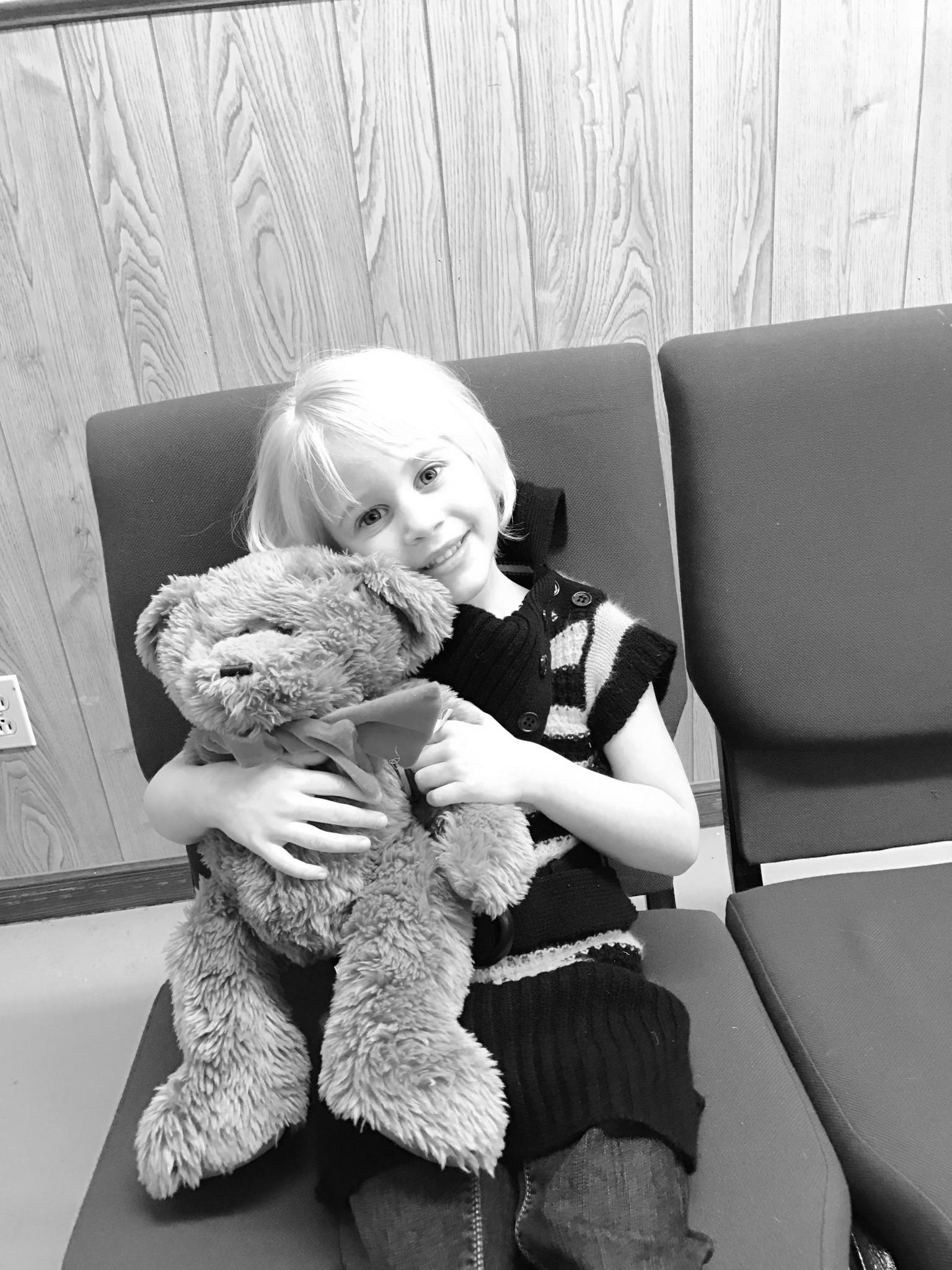 Becky Uehling | NLT<strong>Allahna Finch, 5, from Paxton snuggles one of the bears at New Life Lutheran.</strong>